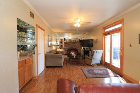 Step Down Family Rm w/ Brick Fire Place + Wet Bar