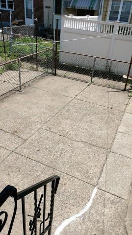 Fenced Rear Yard cement Patio